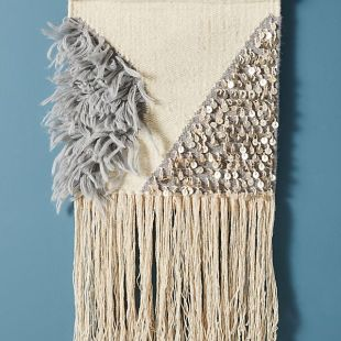 https://www.anthropologie.com/shop/lucy-fringed-wall-hanging?category=sale-room-wall-decor&color=008&quantity=1&size=One%20Size&type=REGULAR