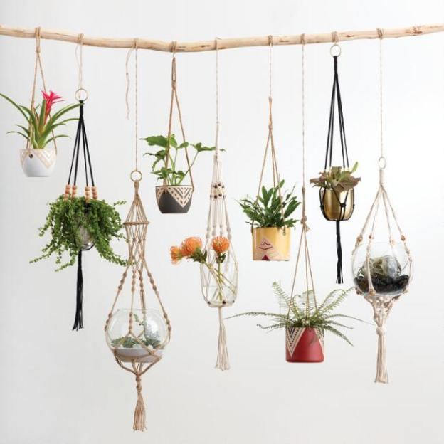 https://www.worldmarket.com/product/natural-bead-macrame-plant-hanger.do